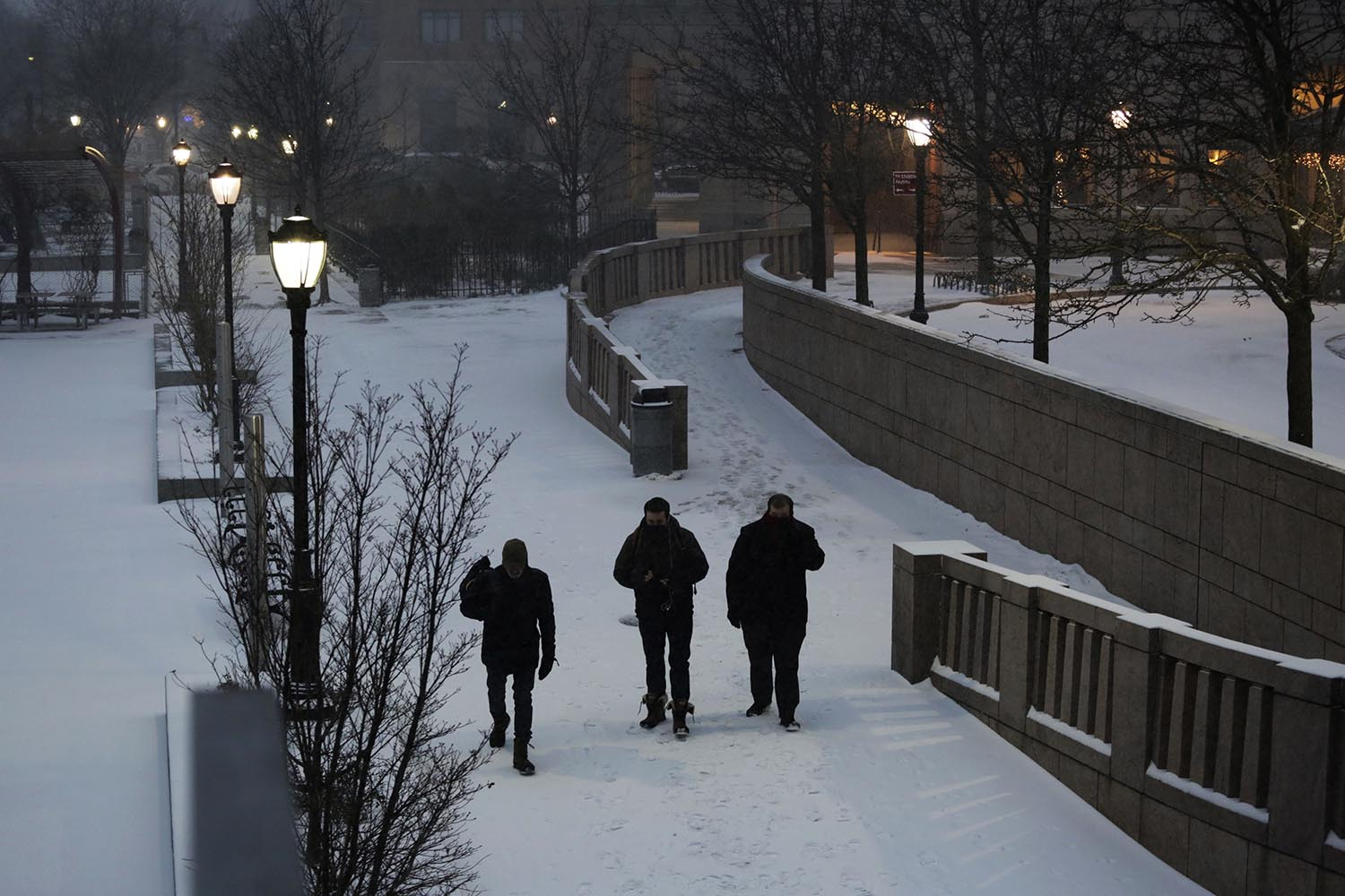 "<div class=""meta image-caption""><div class=""origin-logo origin-image ap""><span>AP</span></div><span class=""caption-text"">Men walk through an early morning snowfall, Thursday, Jan. 4, 2018, in New York. (AP Photo/Mark Lennihan)</span></div>"