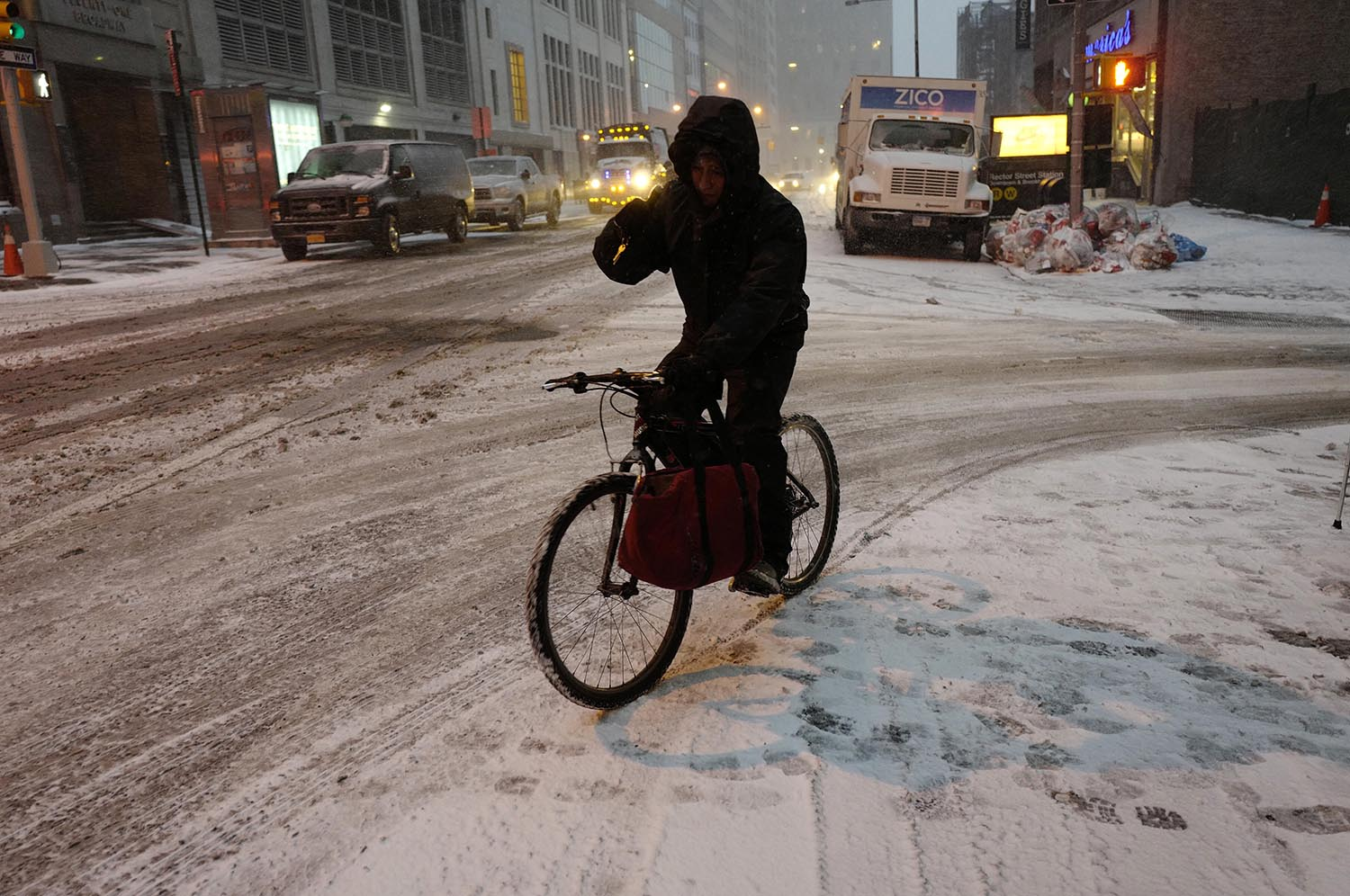 <div class='meta'><div class='origin-logo' data-origin='AP'></div><span class='caption-text' data-credit='AP Photo/Mark Lennihan'>A bicyclist maneuvers through an early morning snowfall, Thursday, Jan. 4, 2018, in New York.</span></div>