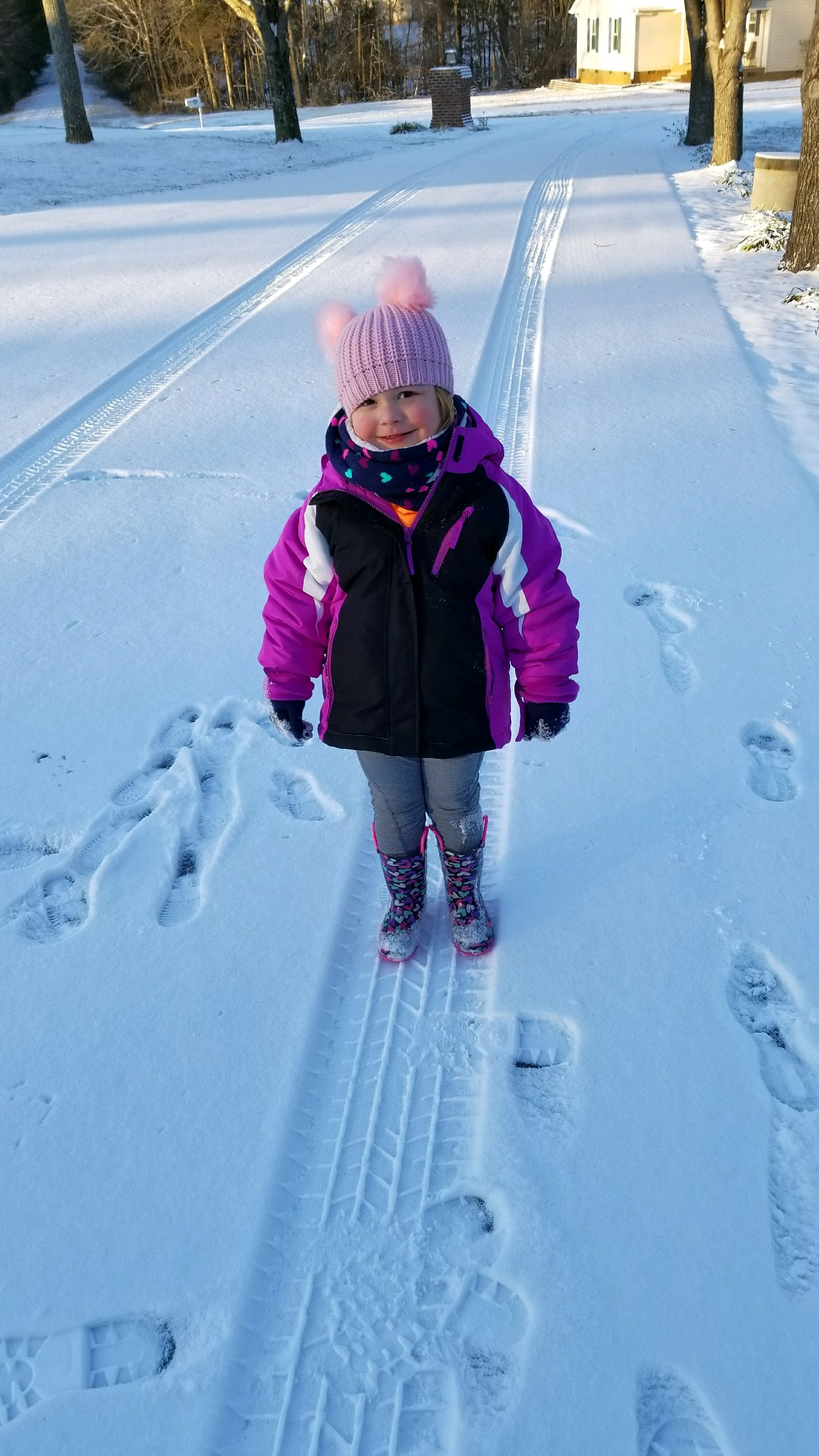"<div class=""meta image-caption""><div class=""origin-logo origin-image none""><span>none</span></div><span class=""caption-text"">3-year-old Isla Williams enjoying the snow in Mebane (Credit: Marsha Rudd)</span></div>"