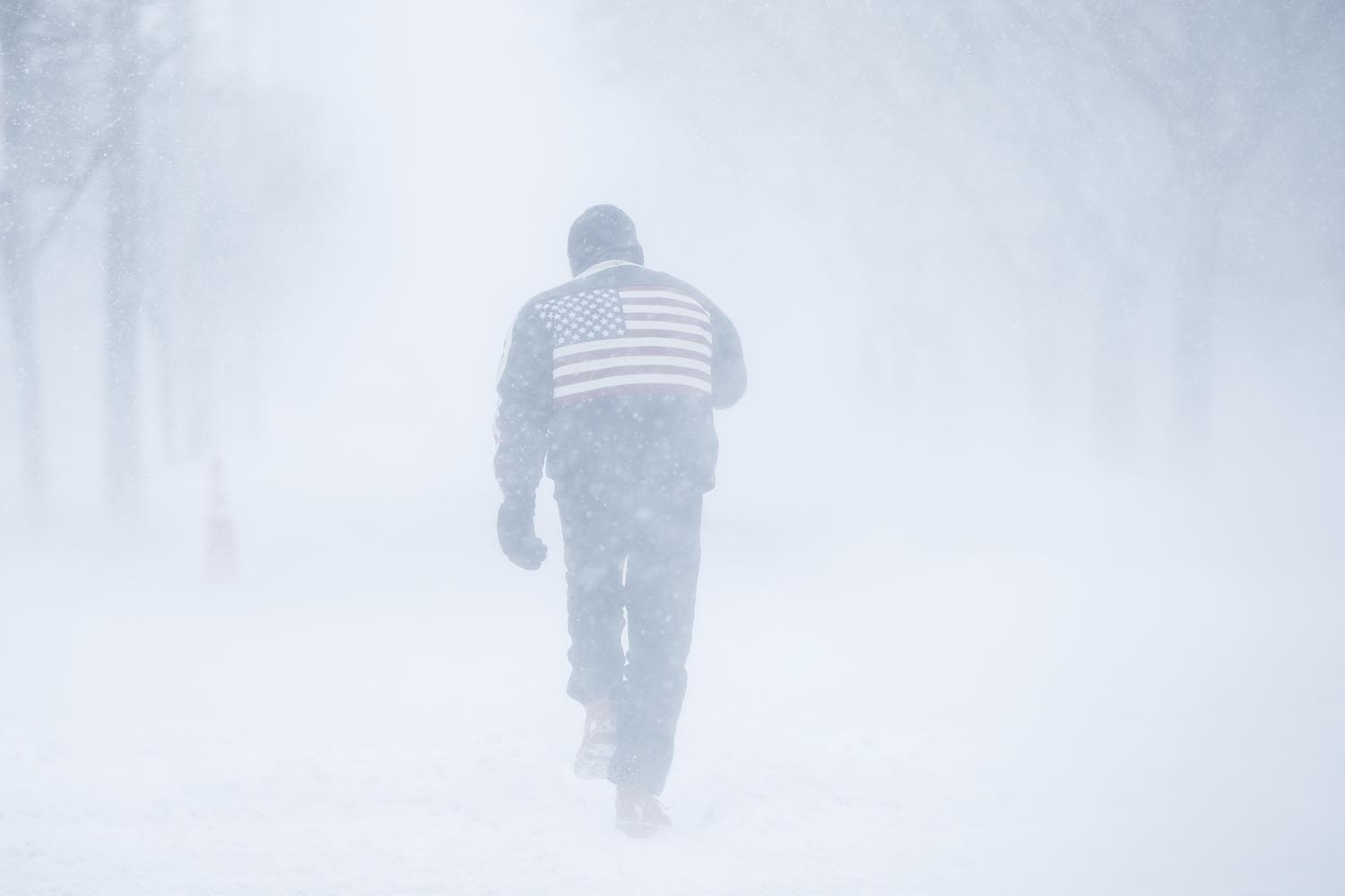 "<div class=""meta image-caption""><div class=""origin-logo origin-image ap""><span>AP</span></div><span class=""caption-text"">A man pushes his way through driving winds during a winter snowstorm in Atlantic City, N.J., Thursday, Jan. 4, 2018. (AP Photo/Matt Rourke)</span></div>"