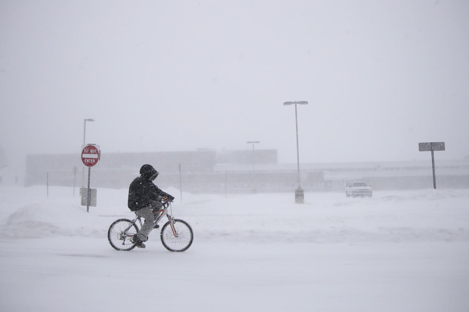"<div class=""meta image-caption""><div class=""origin-logo origin-image ap""><span>AP</span></div><span class=""caption-text"">Justin Hartman rides his bicycle along New Bedford Road in whiteout conditions during a snowstorm, Thursday, Jan. 4, 2018, in Wall Township, N.J. (AP Photo/Julio Cortez)</span></div>"