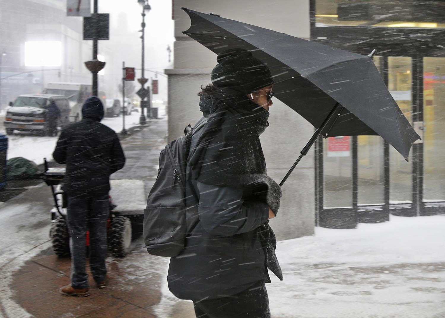 <div class='meta'><div class='origin-logo' data-origin='AP'></div><span class='caption-text' data-credit='AP Photo/Seth Wenig'>A pedestrian uses an umbrella as a shield from the windblown snow in New York, Thursday, Jan. 4, 2018.</span></div>