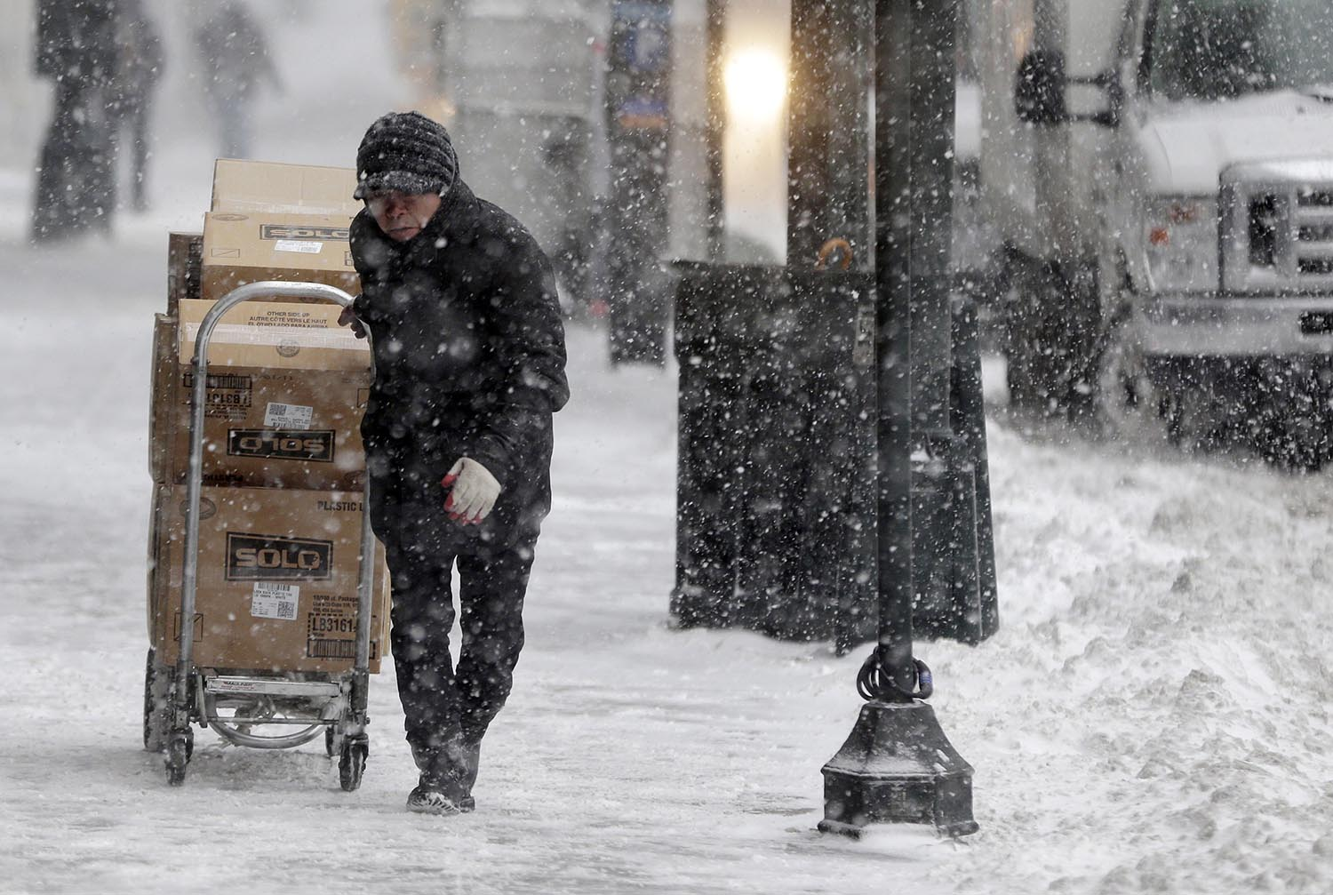"<div class=""meta image-caption""><div class=""origin-logo origin-image ap""><span>AP</span></div><span class=""caption-text"">A man struggles to make a delivery through snowy streets in New York, Thursday, Jan. 4, 2018. (AP Photo/Seth Wenig)</span></div>"