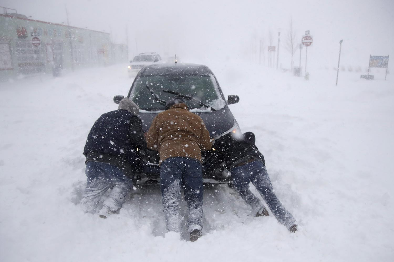 "<div class=""meta image-caption""><div class=""origin-logo origin-image ap""><span>AP</span></div><span class=""caption-text"">A group of men help a motorist after his vehicle was stuck in the snow near Asbury Park boardwalk during a snowstorm, Thursday, Jan. 4, 2018, in Asbury Park, N.J. (AP Photo/Julio Cortez)</span></div>"