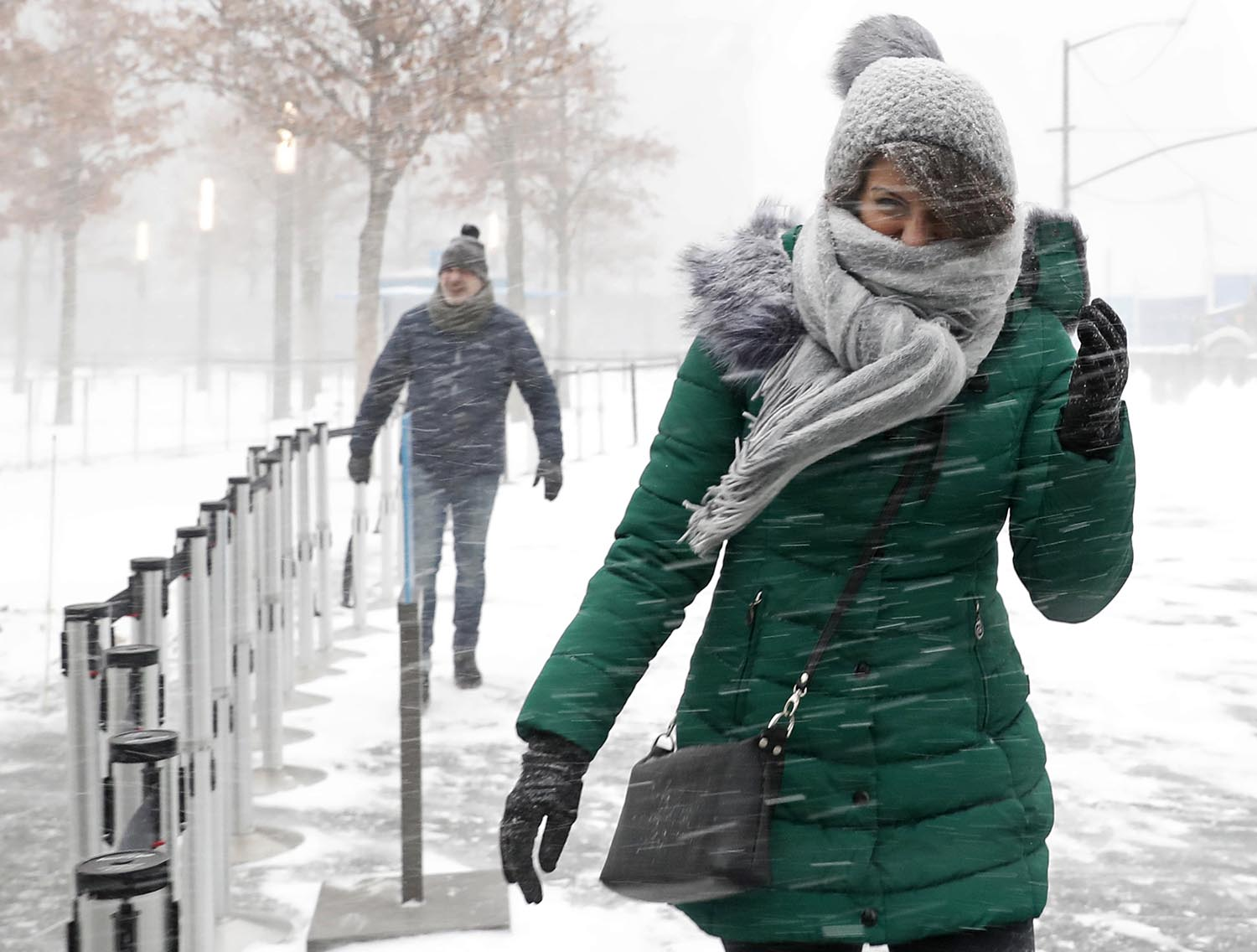 "<div class=""meta image-caption""><div class=""origin-logo origin-image ap""><span>AP</span></div><span class=""caption-text"">Pedestrians make their way across a plaza as strong winds blow the snow horizontally outside the National September 11 Memorial and Museum in New York, Thursday, Jan. 4, 2018. (AP Photo/Kathy Willens)</span></div>"