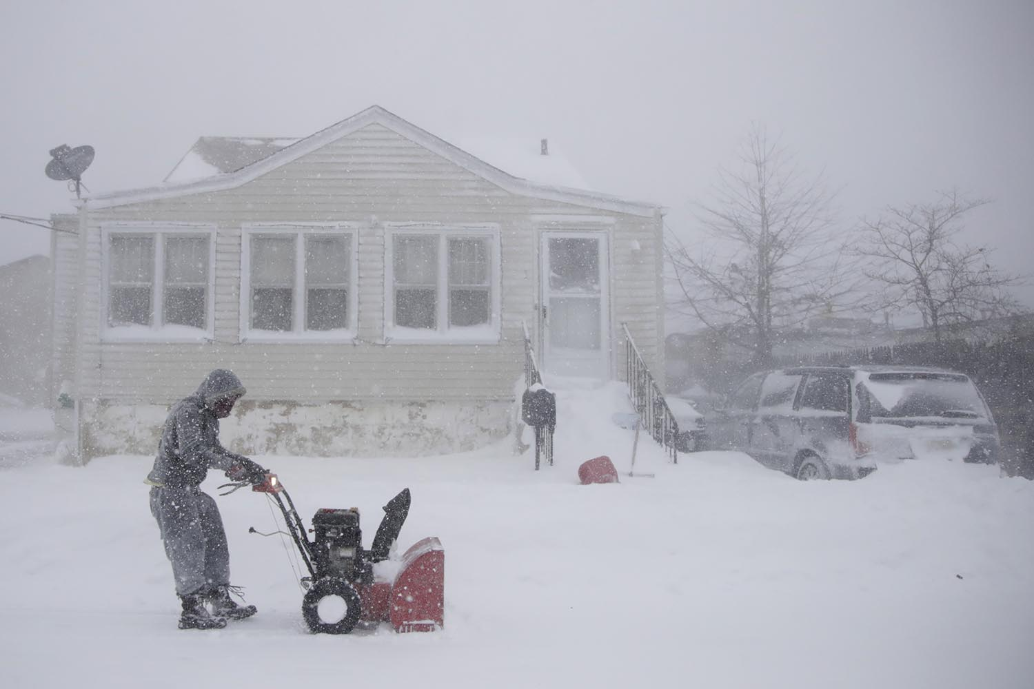 <div class='meta'><div class='origin-logo' data-origin='AP'></div><span class='caption-text' data-credit='AP Photo/Julio Cortez'>Gilberto Colin gets a head start on snowplowing his property during the middle of a snowstorm, Thursday, Jan. 4, 2018, in Neptune, N.J.</span></div>