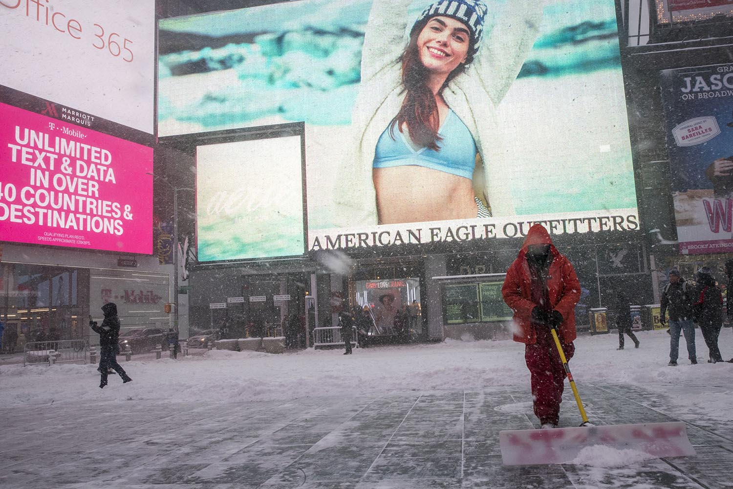 <div class='meta'><div class='origin-logo' data-origin='AP'></div><span class='caption-text' data-credit='AP Photo/Mary Altaffer'>A worker with the Times Square alliance clears snow from the pedestrian walkway, Thursday, Jan. 4, 2018, in New York's Times Square.</span></div>