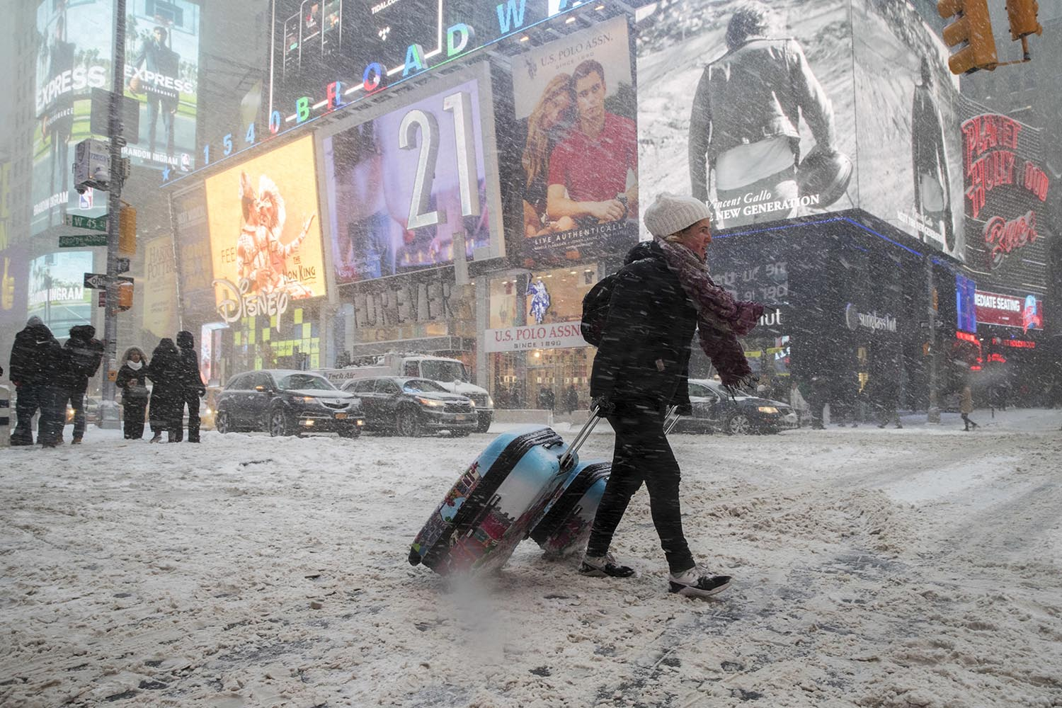 "<div class=""meta image-caption""><div class=""origin-logo origin-image ap""><span>AP</span></div><span class=""caption-text"">Rebecca Hollis of New Zealand drags her suitcases in a snowstorm through Times Square on her way to a hotel, Thursday, Jan. 4, 2018, in New York. (AP Photo/Mary Altaffer)</span></div>"