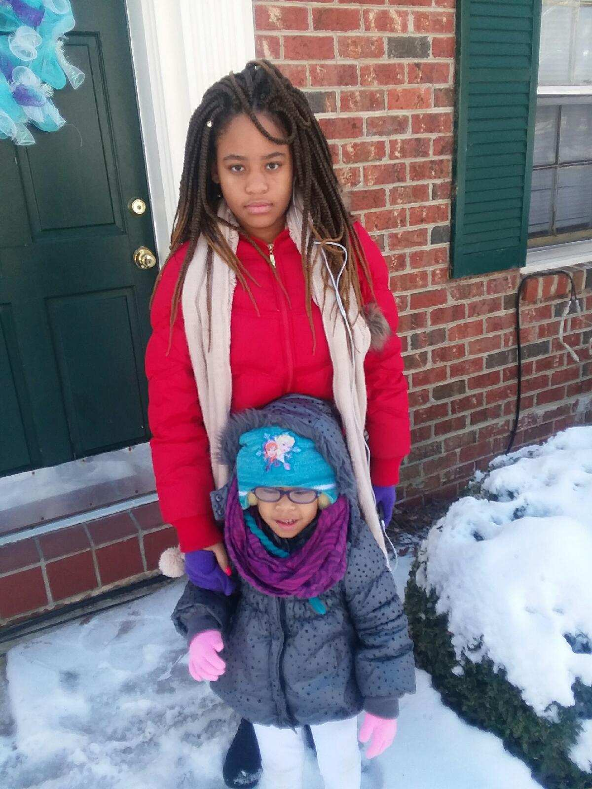 "<div class=""meta image-caption""><div class=""origin-logo origin-image none""><span>none</span></div><span class=""caption-text"">Jasney Emerson and Kinley Howard enjoying sister love on their snow-day off. (Regina Emerson - ABC11 Eyewitness)</span></div>"