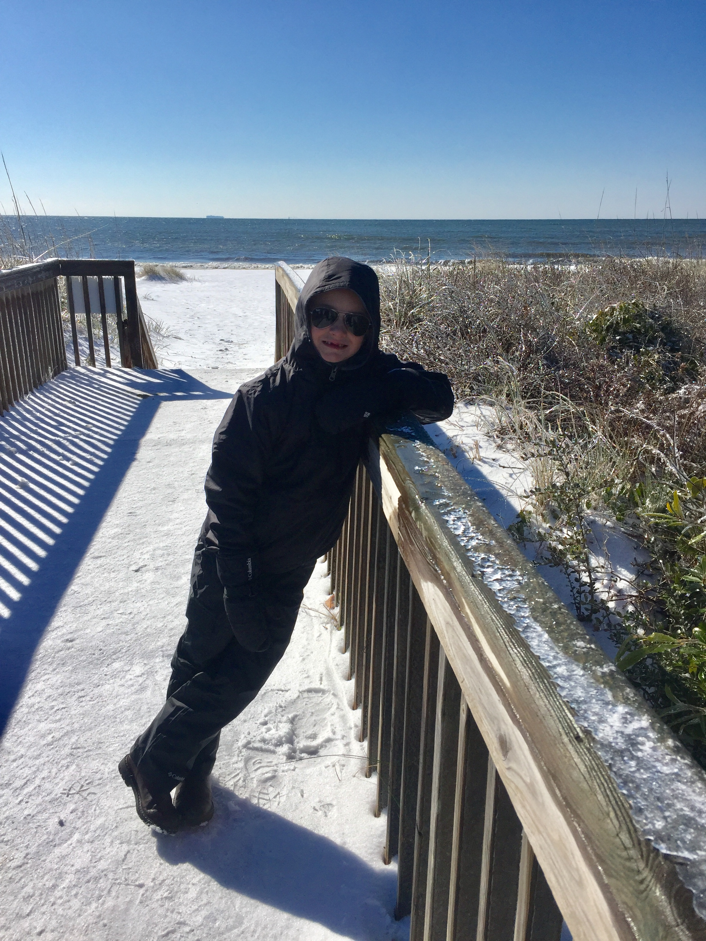 "<div class=""meta image-caption""><div class=""origin-logo origin-image none""><span>none</span></div><span class=""caption-text"">Max Mena, 6, enjoys snow at the beach at Caswell on Oak Island! (Michelle Mena - ABC11 Eyewitness)</span></div>"