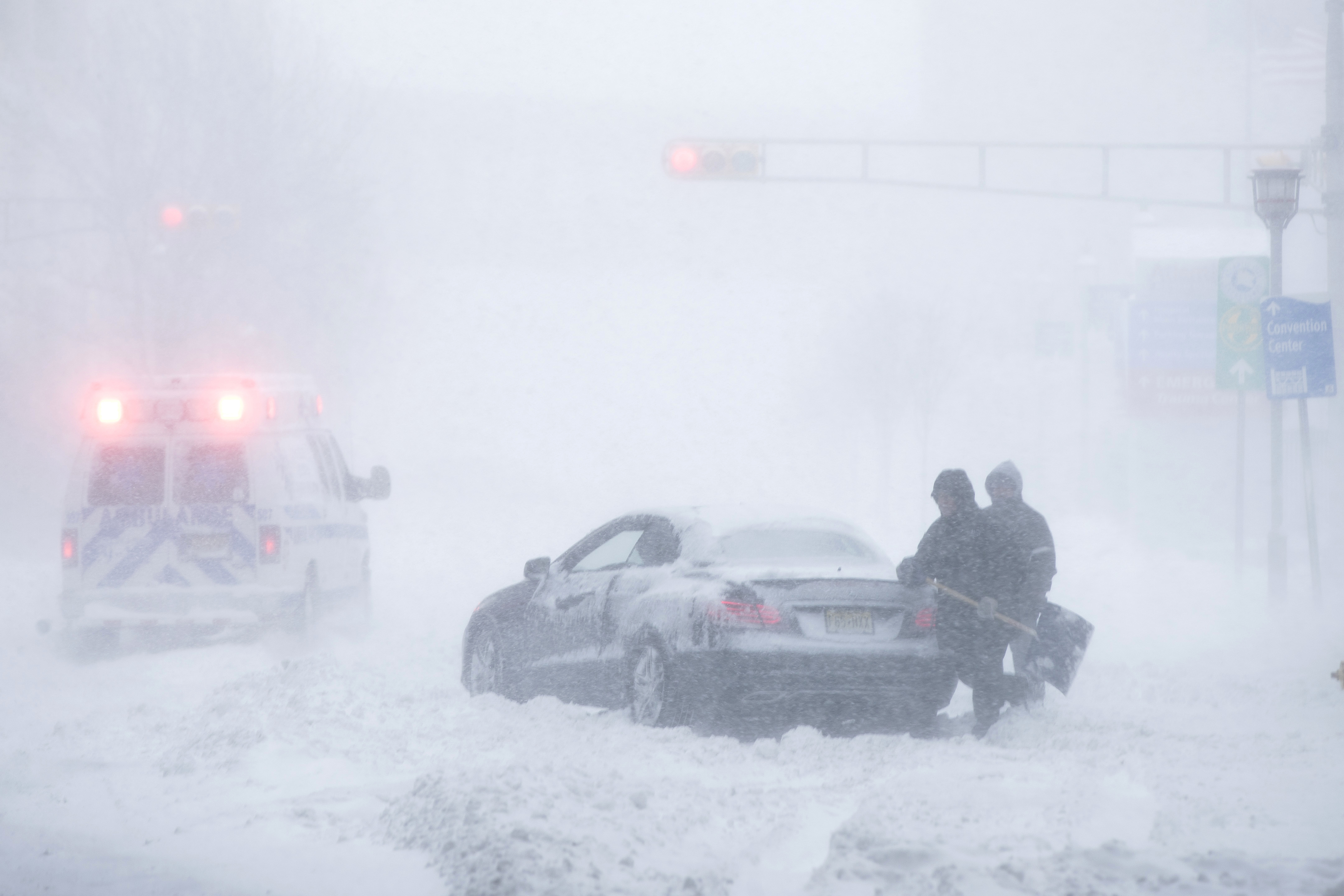 "<div class=""meta image-caption""><div class=""origin-logo origin-image none""><span>none</span></div><span class=""caption-text"">Men work to free a stranded car during a winter snowstorm in Atlantic City, N.J., Thursday, Jan. 4, 2018. (AP Photo/Matt Rourke) (AP)</span></div>"