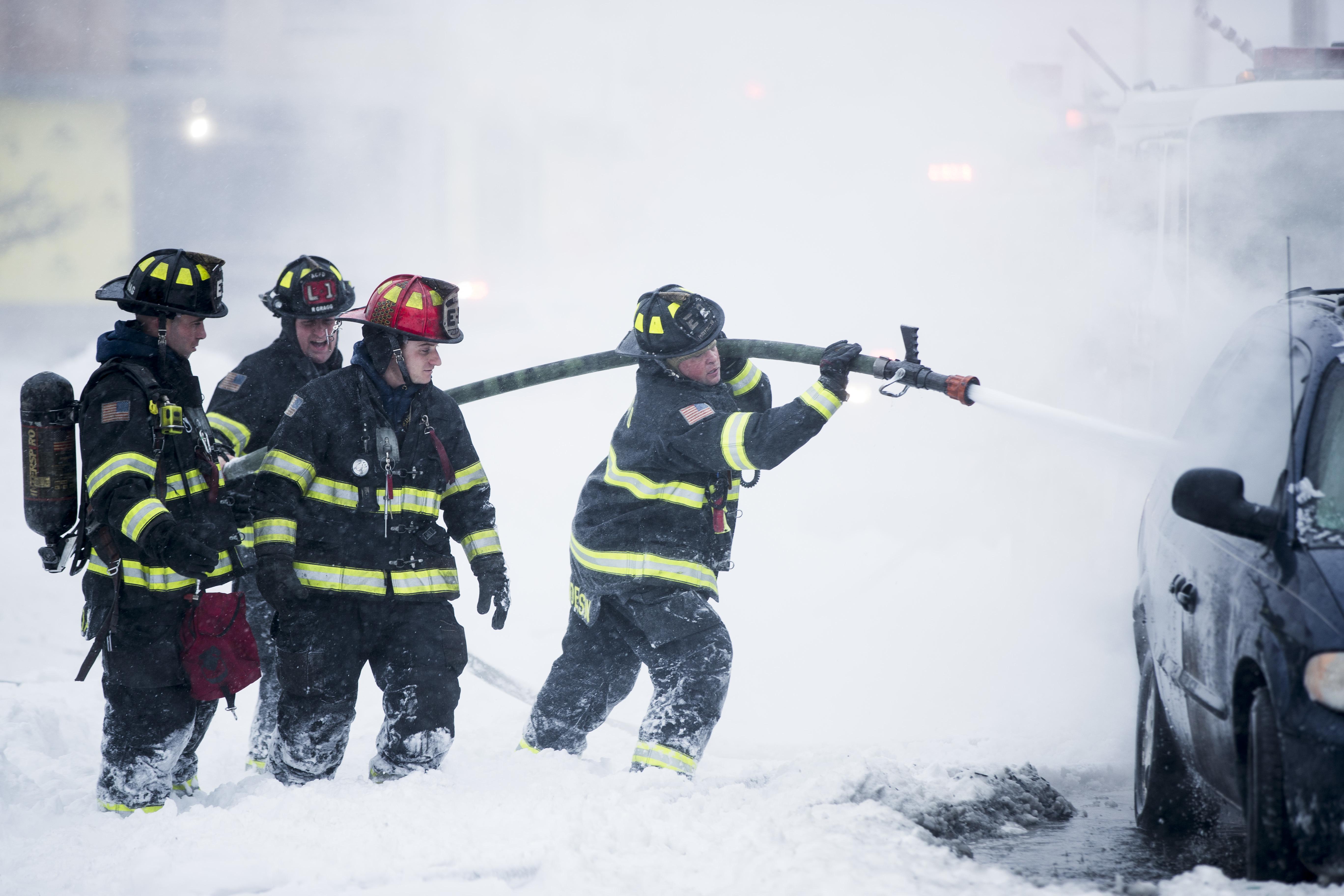 "<div class=""meta image-caption""><div class=""origin-logo origin-image none""><span>none</span></div><span class=""caption-text"">Firefighters extinguish a vehicle fire during a winter snowstorm in Atlantic City, N.J., Thursday, Jan. 4, 2018.  (AP Photo/Matt Rourke) (AP)</span></div>"