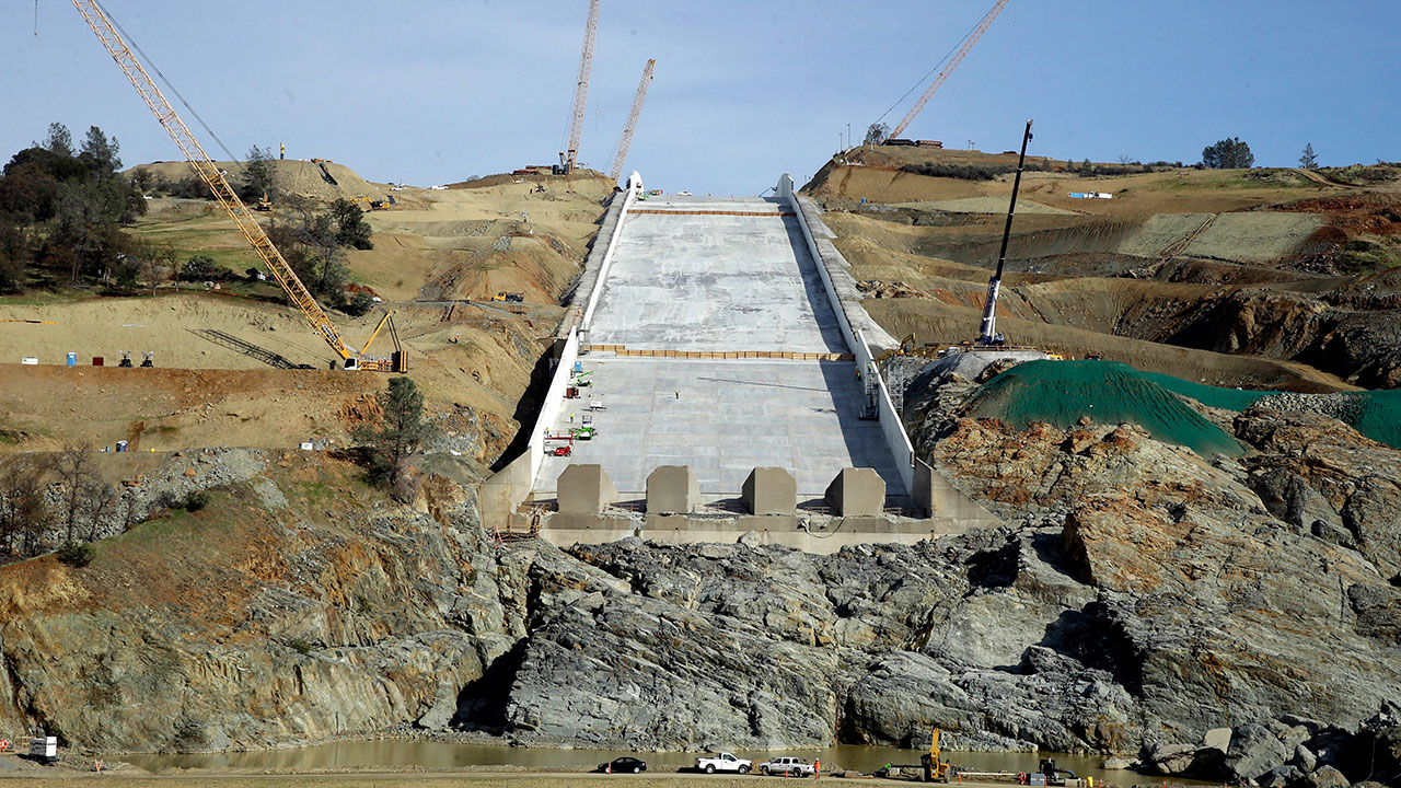 FILE - In this Nov. 30, 2017, file photo, work continues on the Oroville Dam spillway in Oroville, Calif.