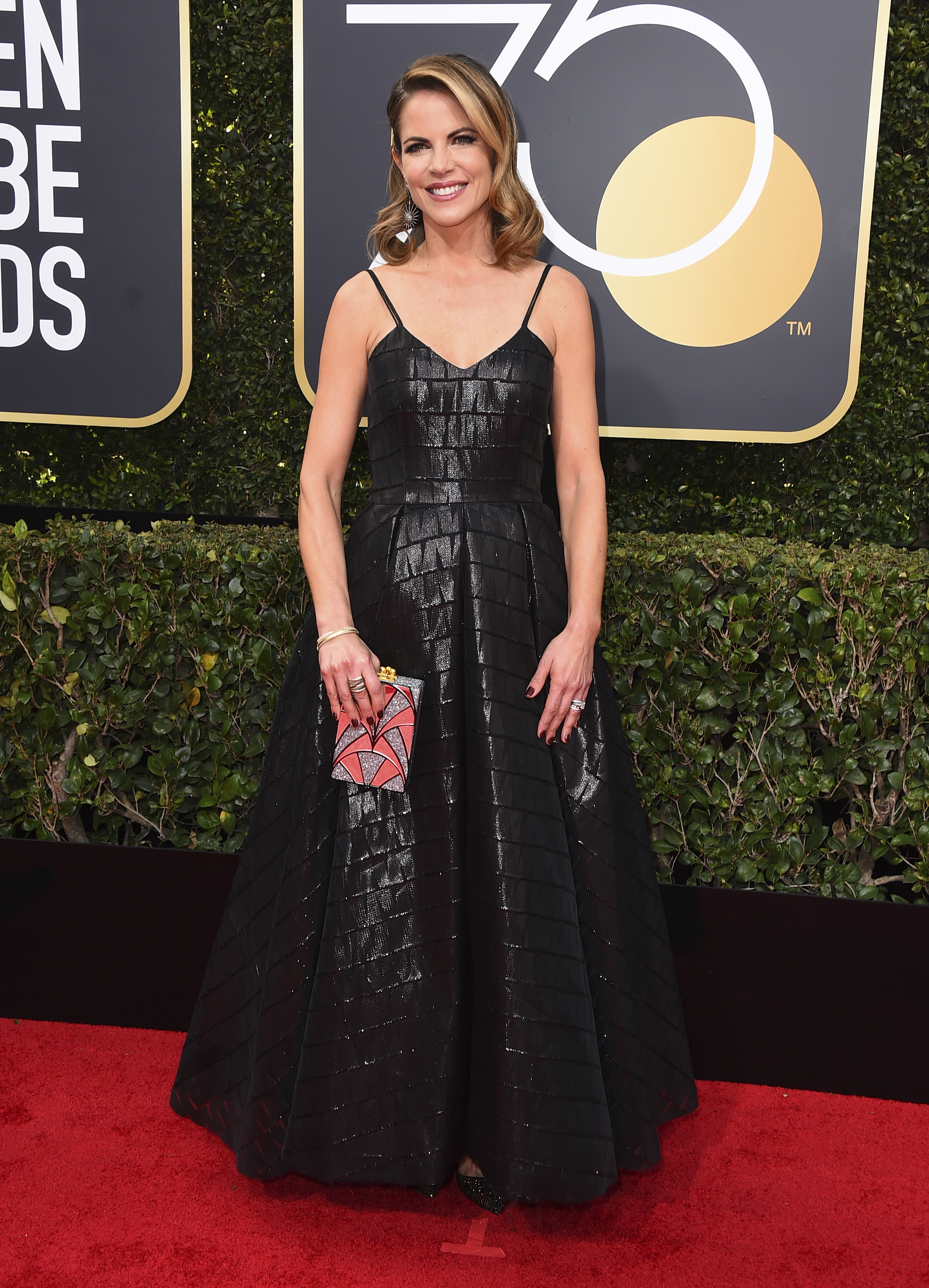 <div class='meta'><div class='origin-logo' data-origin='AP'></div><span class='caption-text' data-credit='Jordan Strauss/Invision/AP'>Natalie Morales arrives at the 75th annual Golden Globe Awards at the Beverly Hilton Hotel on Sunday, Jan. 7, 2018, in Beverly Hills, Calif.</span></div>