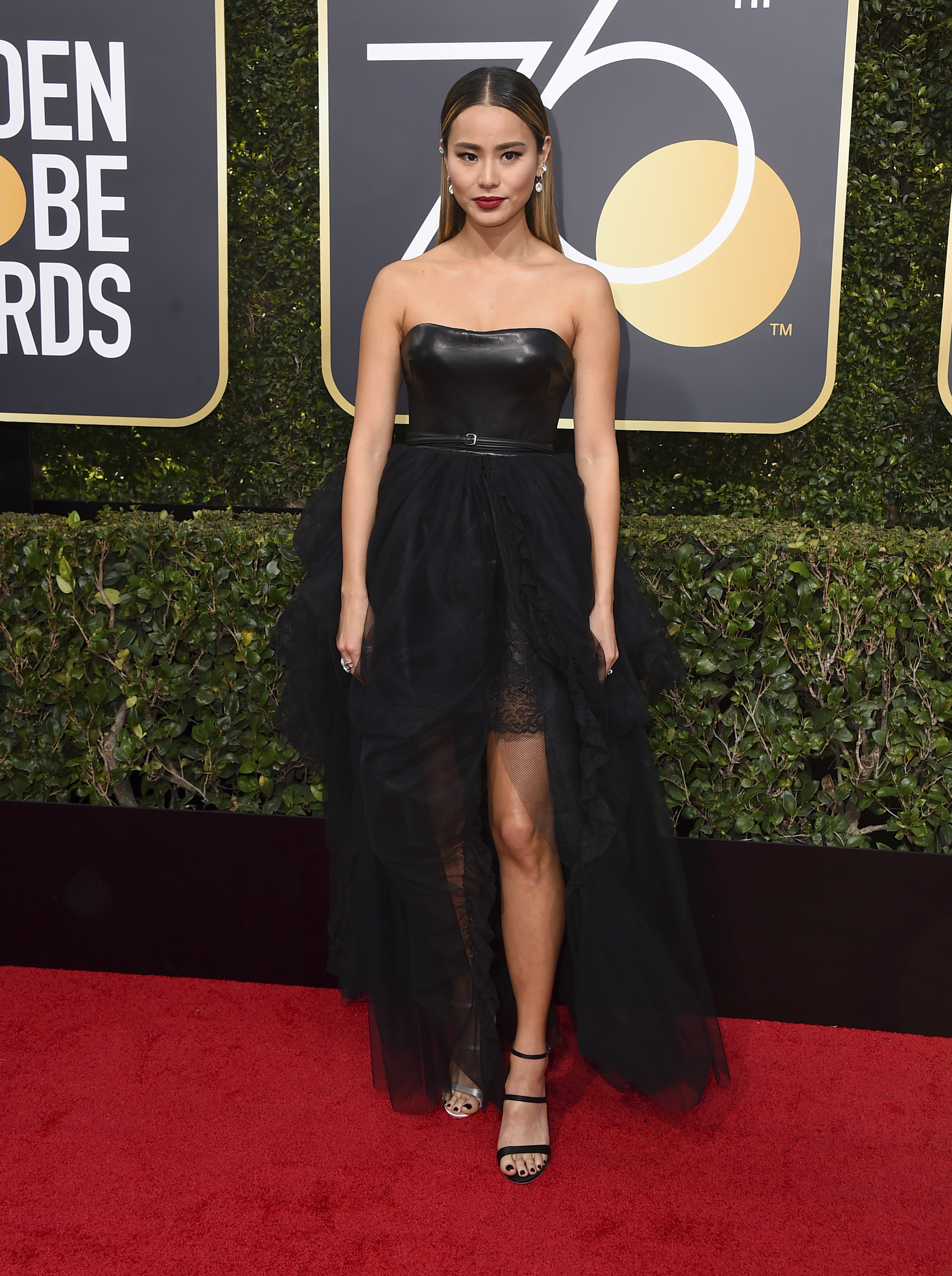 <div class='meta'><div class='origin-logo' data-origin='AP'></div><span class='caption-text' data-credit='Jordan Strauss/Invision/AP'>Jamie Chung arrives at the 75th annual Golden Globe Awards at the Beverly Hilton Hotel on Sunday, Jan. 7, 2018, in Beverly Hills, Calif.</span></div>