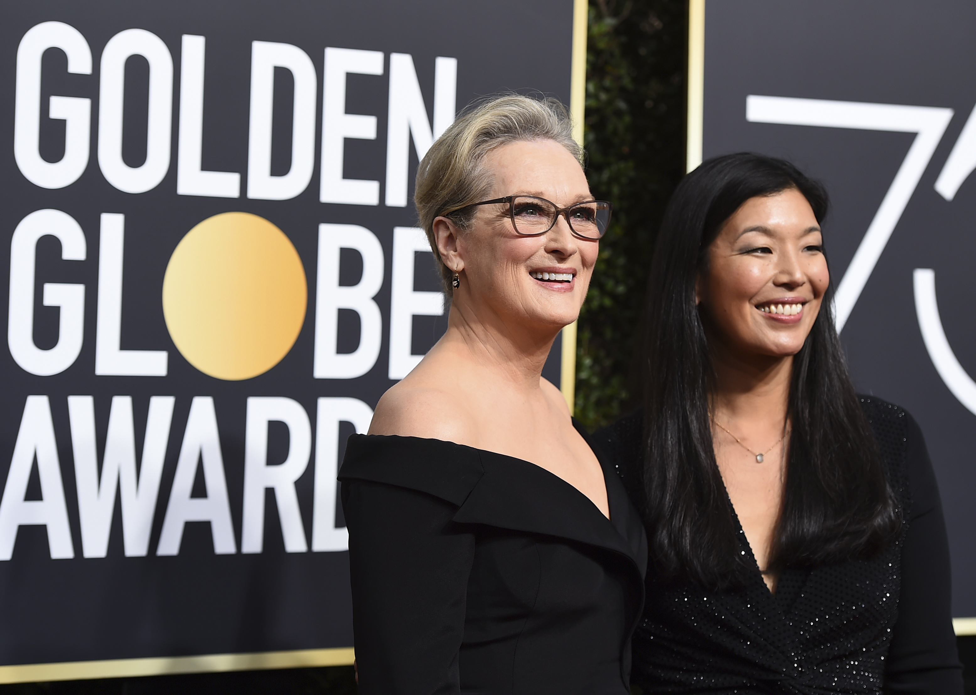 <div class='meta'><div class='origin-logo' data-origin='AP'></div><span class='caption-text' data-credit='Jordan Strauss/Invision/AP'>Meryl Streep, left, and Ai-jen Poo arrive at the 75th annual Golden Globe Awards at the Beverly Hilton Hotel on Sunday, Jan. 7, 2018, in Beverly Hills, Calif.</span></div>