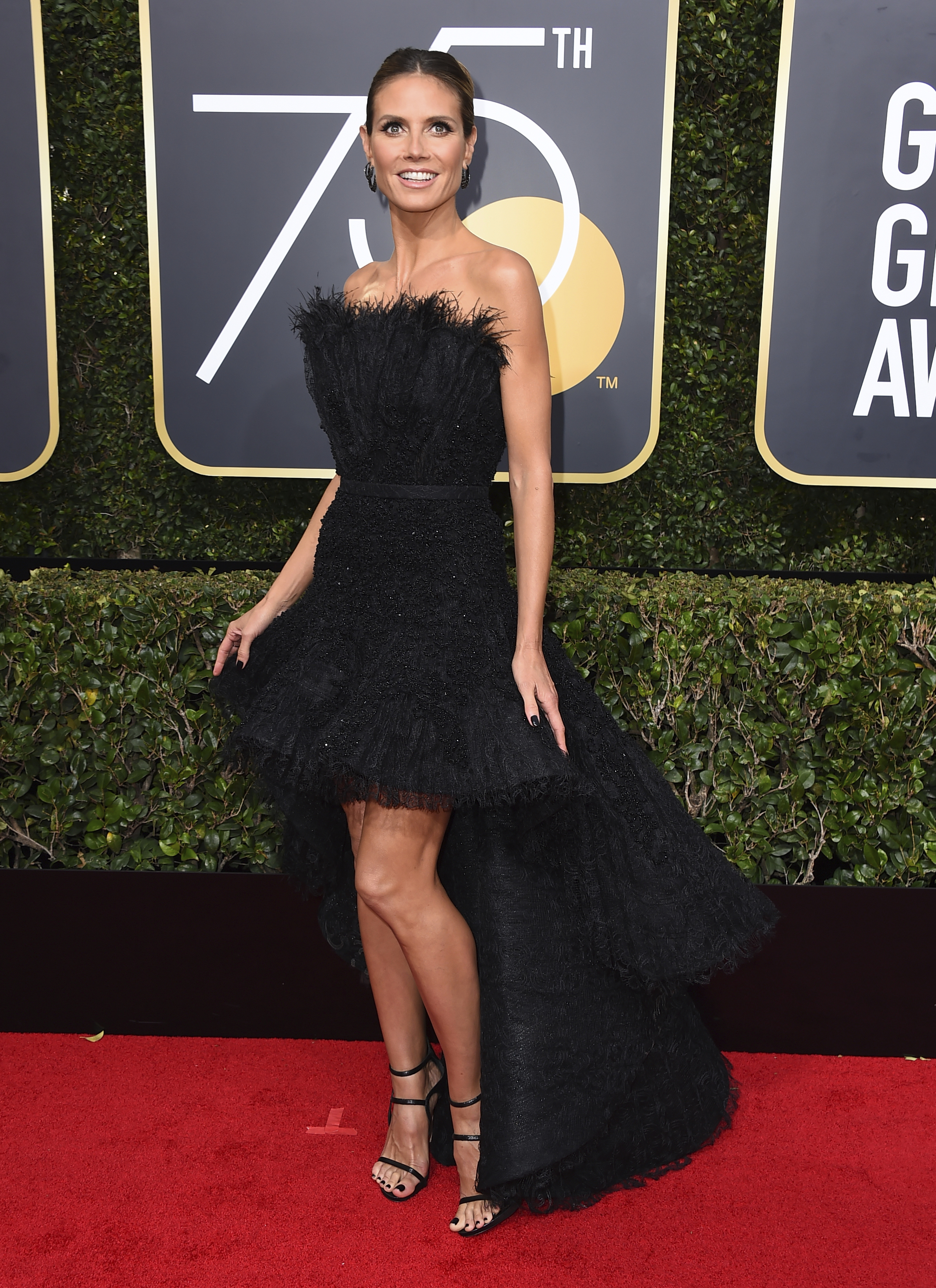 <div class='meta'><div class='origin-logo' data-origin='AP'></div><span class='caption-text' data-credit='Jordan Strauss/Invision/AP'>Heidi Klum arrives at the 75th annual Golden Globe Awards at the Beverly Hilton Hotel on Sunday, Jan. 7, 2018, in Beverly Hills, Calif.</span></div>