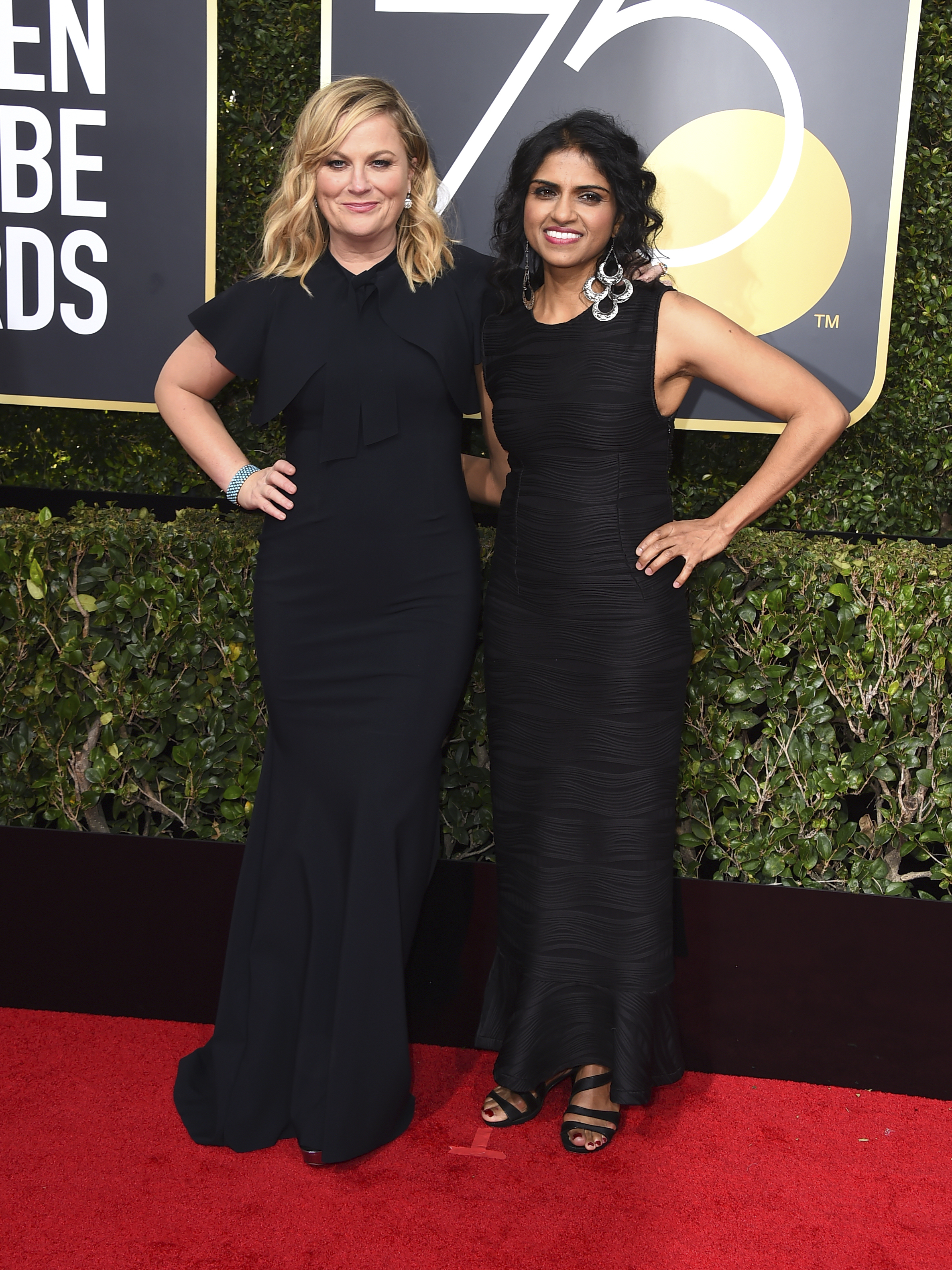 <div class='meta'><div class='origin-logo' data-origin='AP'></div><span class='caption-text' data-credit='Jordan Strauss/Invision/AP'>Amy Poehler, left, and Saru Jayaraman arrive at the 75th annual Golden Globe Awards at the Beverly Hilton Hotel on Sunday, Jan. 7, 2018, in Beverly Hills, Calif.</span></div>