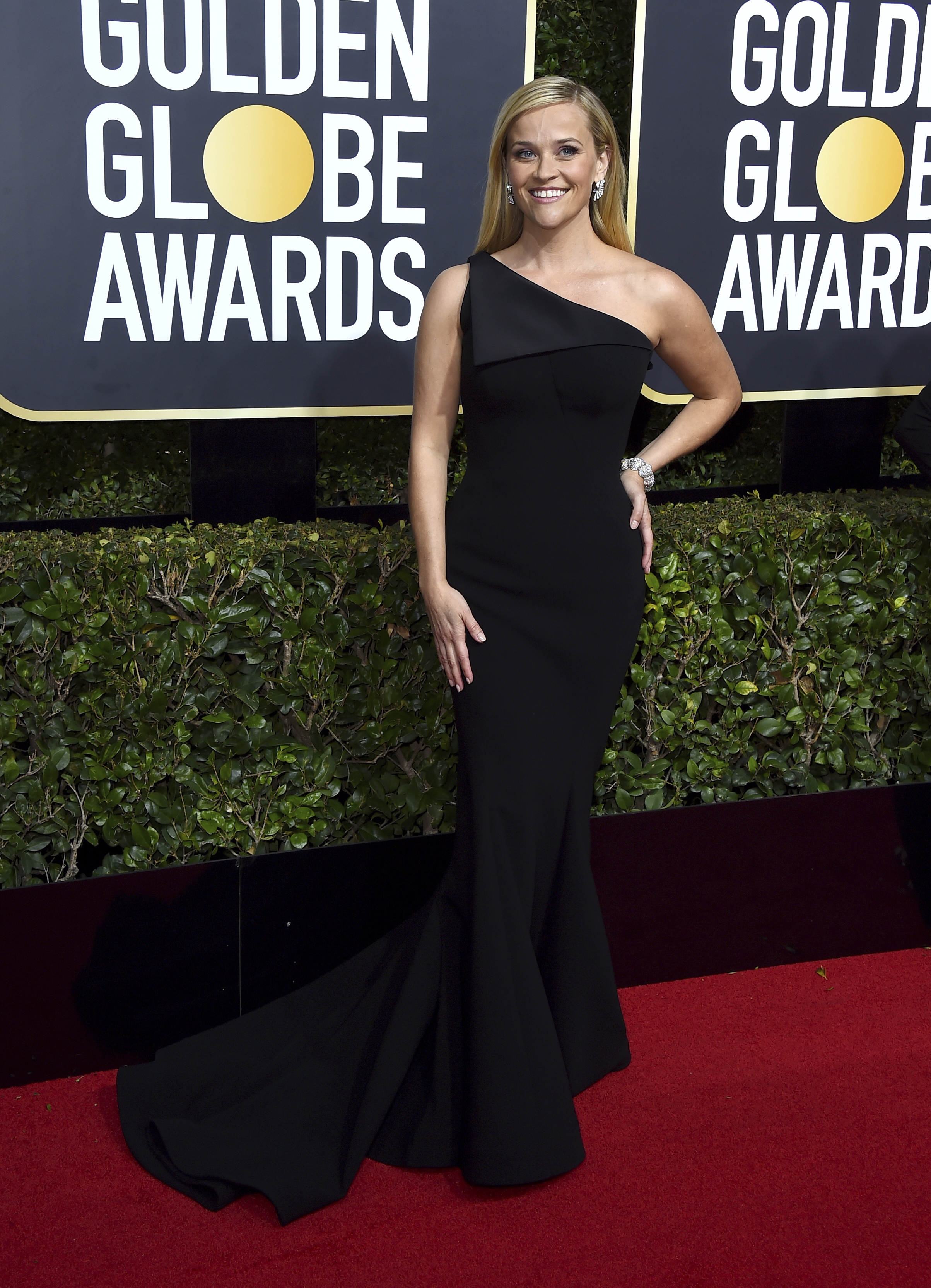 <div class='meta'><div class='origin-logo' data-origin='AP'></div><span class='caption-text' data-credit='Jordan Strauss/Invision/AP'>Reese Witherspoon arrives at the 75th annual Golden Globe Awards at the Beverly Hilton Hotel on Sunday, Jan. 7, 2018, in Beverly Hills, Calif.</span></div>