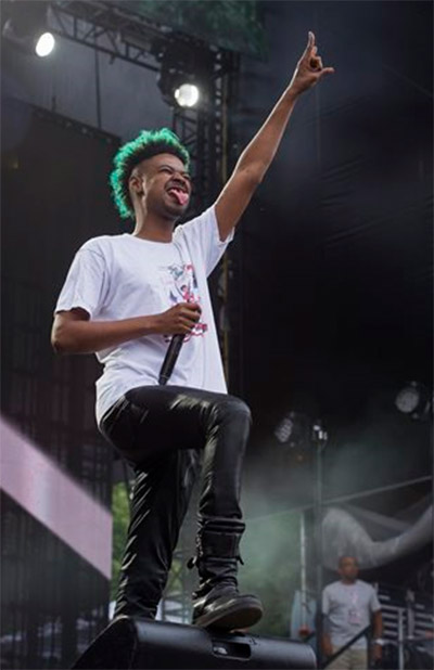 """<div class=""""meta image-caption""""><div class=""""origin-logo origin-image """"><span></span></div><span class=""""caption-text"""">Danny Brown performs on day two of the Budweiser Made in America Festival on Sunday, August 31, 2014 in Philadelphia. ((Photo by Charles Sykes/Invision/AP))</span></div>"""