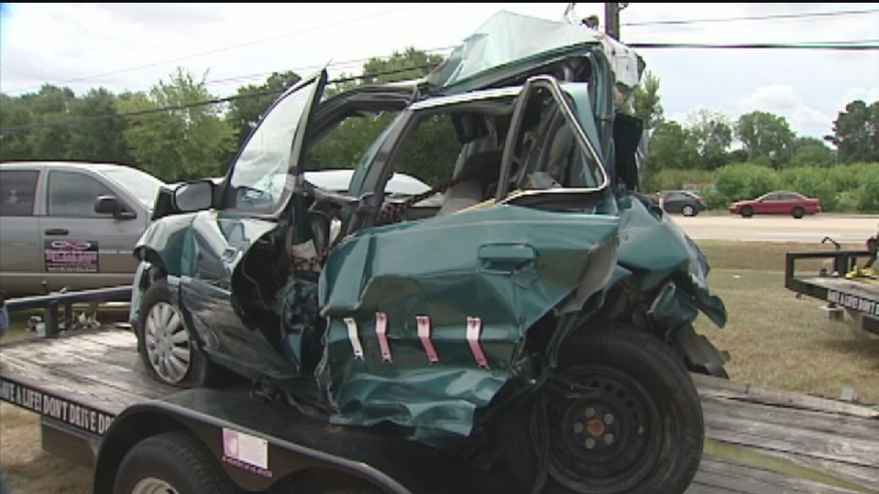 DWI message with wrecked cars