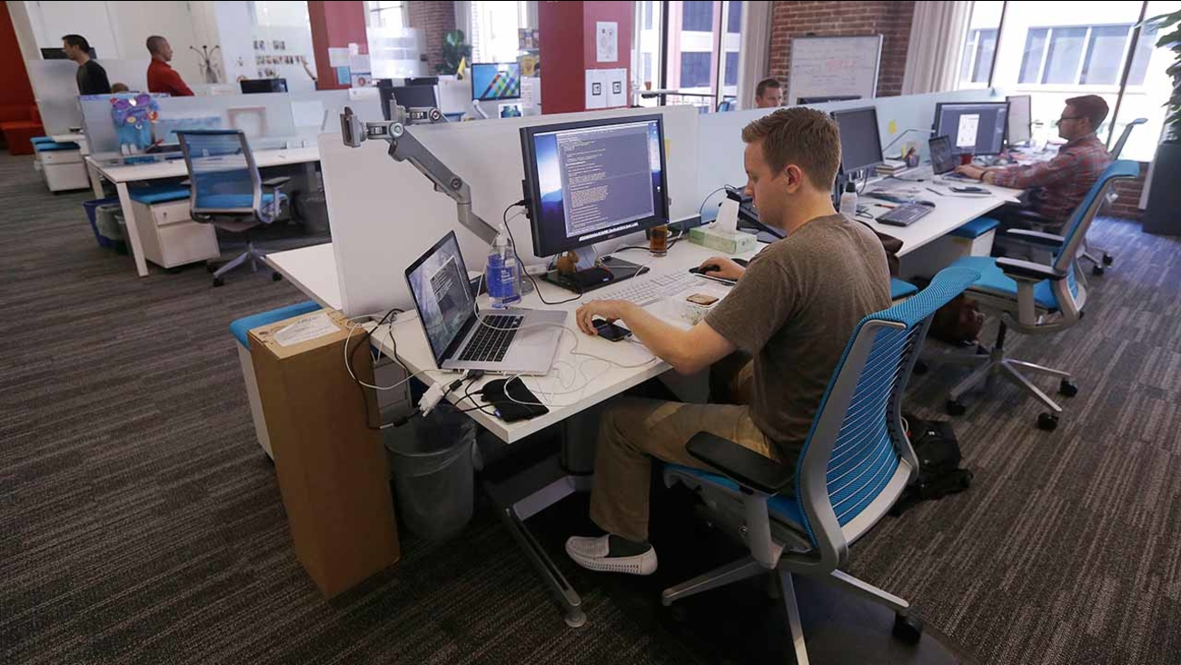 Workers at the Target Technology Innovation Center office in San Francisco.