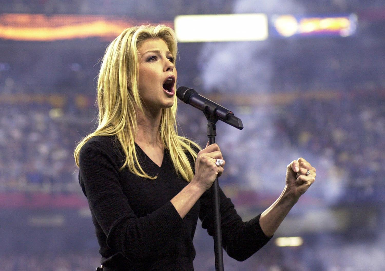 <div class='meta'><div class='origin-logo' data-origin='AP'></div><span class='caption-text' data-credit='AP Photo/Dave Martin'>2000: Country singing star Faith Hill sings the national anthem before the start of Super Bowl XXXIV in Atlanta, Sunday Jan.30, 2000.</span></div>