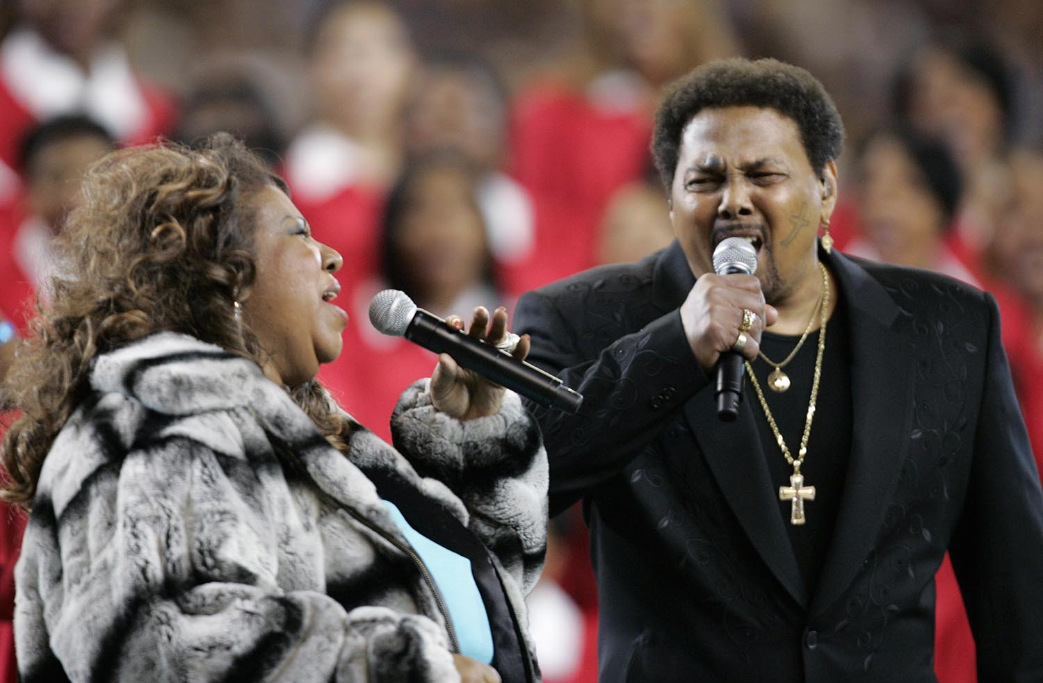 <div class='meta'><div class='origin-logo' data-origin='AP'></div><span class='caption-text' data-credit='AP Photo/David J. Phillip'>2006: Singers Aaron Neville and Aretha Franklin perform the national anthem before the Super Bowl XL football game Sunday, Feb. 5, 2006, in Detroit.</span></div>