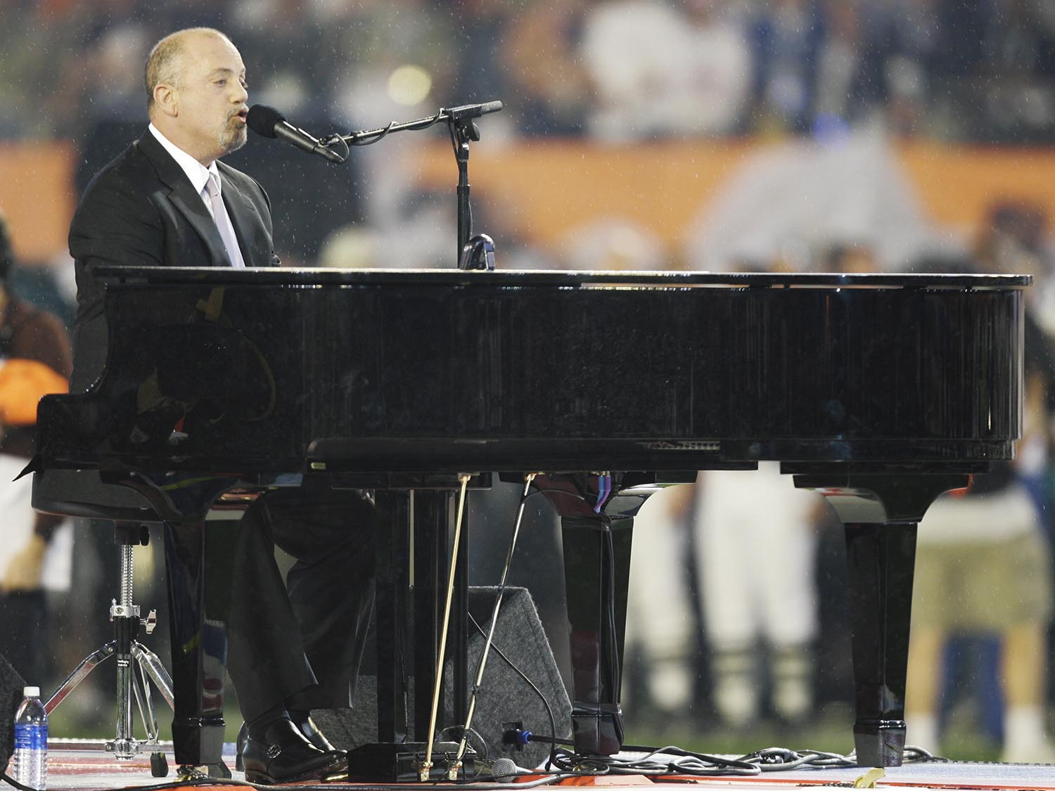 "<div class=""meta image-caption""><div class=""origin-logo origin-image ap""><span>AP</span></div><span class=""caption-text"">2007: Billy Joel sings the national anthem prior to the Super Bowl XLI football game at Dolphin Stadium in Miami on Sunday, Feb. 4, 2007. (AP Photo/Alex Brandon)</span></div>"