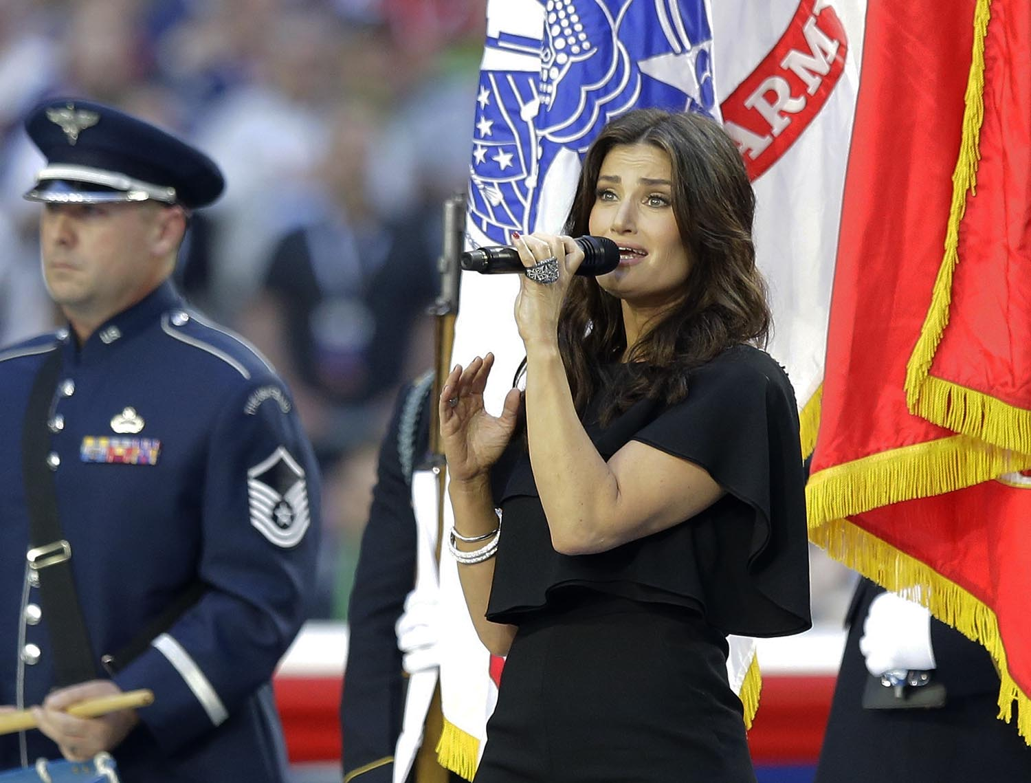 "<div class=""meta image-caption""><div class=""origin-logo origin-image ap""><span>AP</span></div><span class=""caption-text"">2015: Idina Menzel sings the national anthem before the NFL Super Bowl XLIX football game between the Seattle Seahawks and the New England Patriots on Feb. 1, 2015. (AP Photo/Michael Conroy)</span></div>"