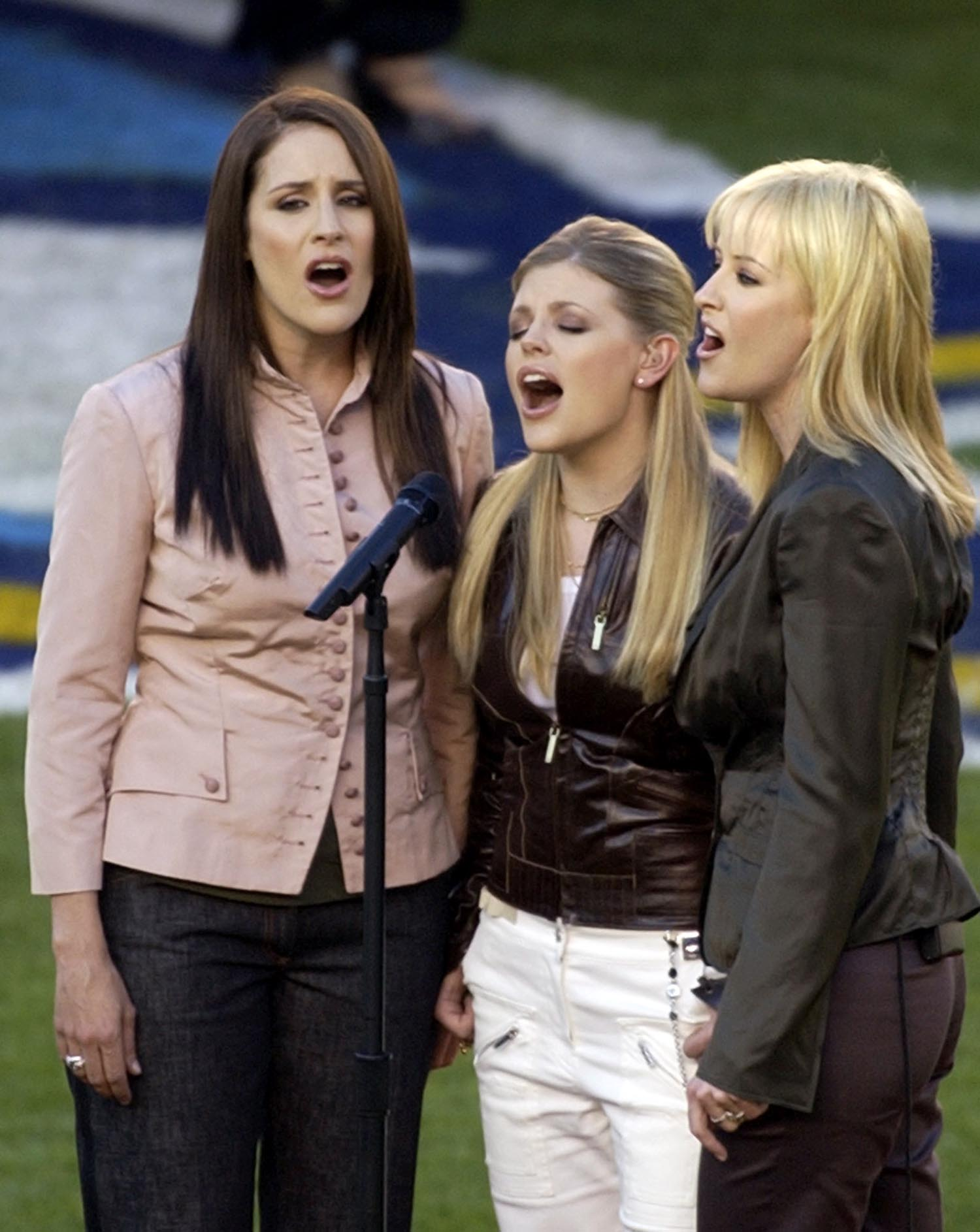 """<div class=""""meta image-caption""""><div class=""""origin-logo origin-image ap""""><span>AP</span></div><span class=""""caption-text"""">2003: The Dixie Chicks, from left, Emily Robison, Natalie Maines and Martie Maguire sing the National Anthem before Super Bowl XXXVII in San Diego, Sunday, Jan. 26, 2003. (AP Photo/Elaine Thompson)</span></div>"""