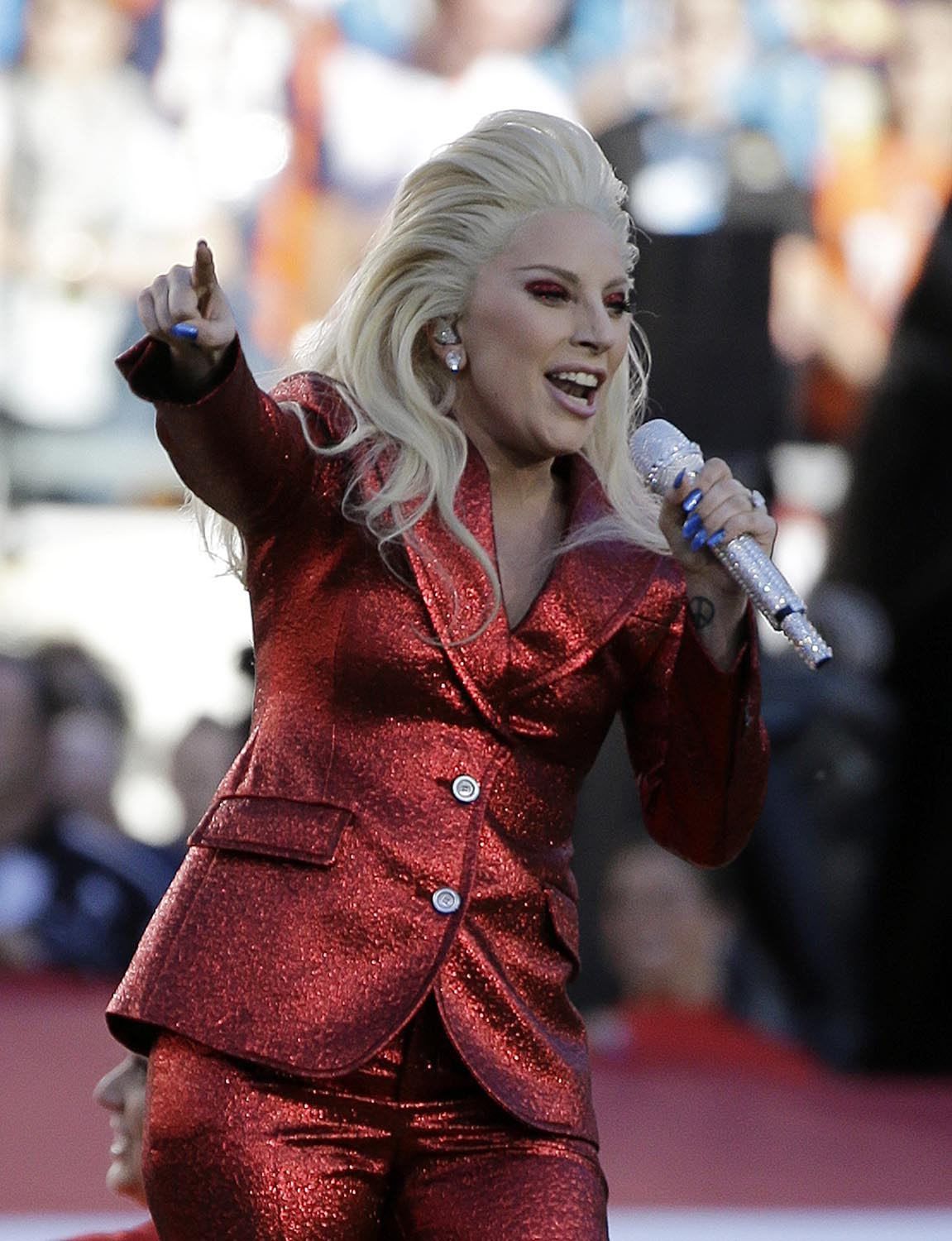 "<div class=""meta image-caption""><div class=""origin-logo origin-image ap""><span>AP</span></div><span class=""caption-text"">2016: Lady Gaga sings the national anthem before the NFL Super Bowl 50 football game between the Denver Broncos and the Carolina Panthers Sunday, Feb. 7, 2016. (AP Photo/Gregory Bull)</span></div>"