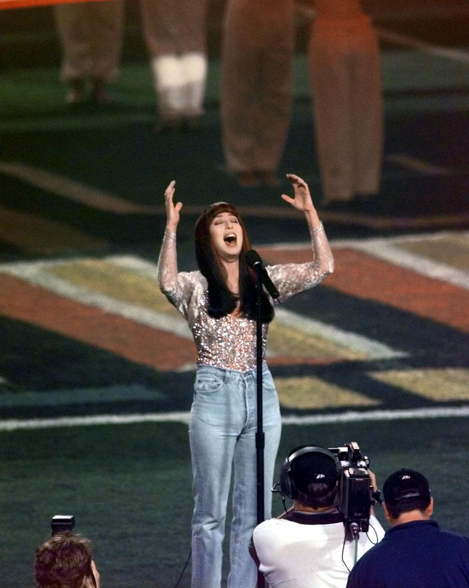 <div class='meta'><div class='origin-logo' data-origin='AP'></div><span class='caption-text' data-credit='AP Photo/Tony Gutierrez'>1999: Cher performs the National Athem before the start of Super Bowl XXXIII in Miami, Sunday, Jan. 31, 1999.</span></div>