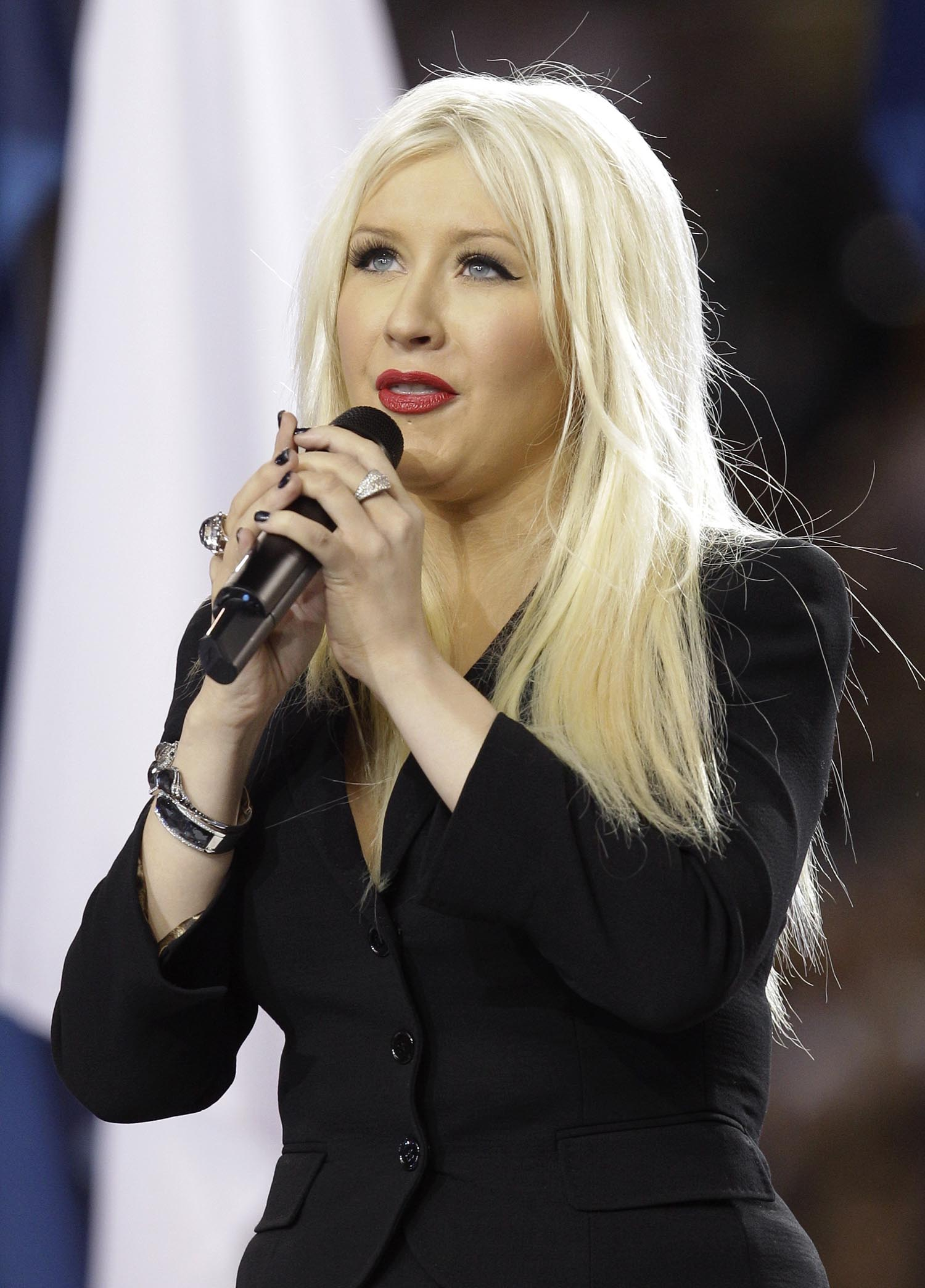 <div class='meta'><div class='origin-logo' data-origin='AP'></div><span class='caption-text' data-credit='AP Photo/David J. Phillip'>2011: Christina Aguilera sings the national anthem before the NFL football Super Bowl XLV game between the Green Bay Packers and the Pittsburgh Steelers in Arlington, Texas.</span></div>