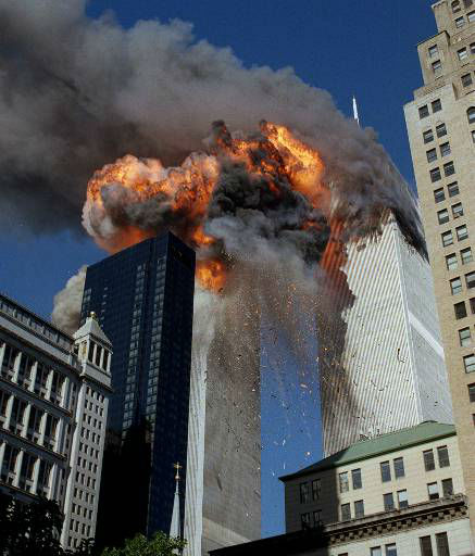 "<div class=""meta image-caption""><div class=""origin-logo origin-image none""><span>none</span></div><span class=""caption-text"">Smoke, flames and debris erupts from one of the World Trade Center towers as a plane strikes it Tuesday, September 11, 2001. (AP Photo/ CHAO SOI CHEONG)</span></div>"