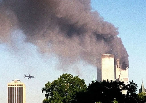<div class='meta'><div class='origin-logo' data-origin='none'></div><span class='caption-text' data-credit='AP Photo/ WILLIAM KRATZKE'>A plane approaches New York's World Trade Center moments before it struck the tower at left, as seen from downtown Brooklyn, Tuesday, Sept. 11, 2001.</span></div>