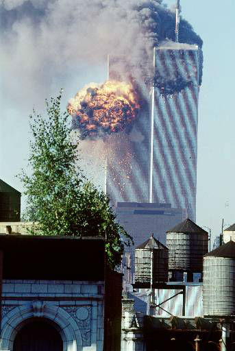 "<div class=""meta image-caption""><div class=""origin-logo origin-image none""><span>none</span></div><span class=""caption-text"">A fireball erupts from one of the World Trade Center towers as it is struck by the second of two airplanes in New York, Tuesday, Sept. 11, 2001. (AP Photo/ TODD HOLLIS)</span></div>"