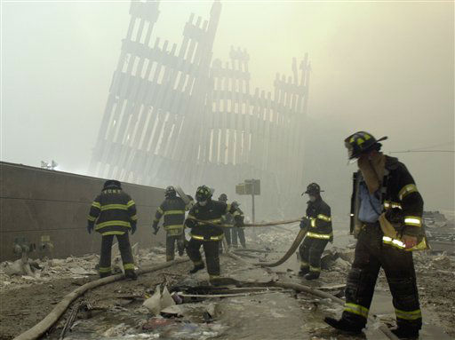 "<div class=""meta image-caption""><div class=""origin-logo origin-image none""><span>none</span></div><span class=""caption-text"">Firefighters work beneath the destroyed mullions, the vertical struts which once faced the soaring outer walls of the World Trade Center towers. (AP Photo/ MARK LENNIHAN)</span></div>"