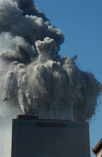 <div class='meta'><div class='origin-logo' data-origin='none'></div><span class='caption-text' data-credit='Photo/Louis Lanzano'>Smoke pours off one of the towers of the World Trade Center as flames explode from the second one as it is struck by a plane Tuesday, Sept. 11, 2001.</span></div>