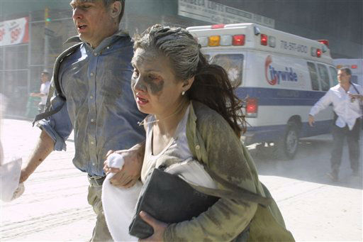 "<div class=""meta image-caption""><div class=""origin-logo origin-image none""><span>none</span></div><span class=""caption-text"">People flee the scene near New York's World Trade Center after terrorists crashed two planes into the towers on Tuesday, September 11, 2001. (AP Photo/ Diane Bondareff)</span></div>"