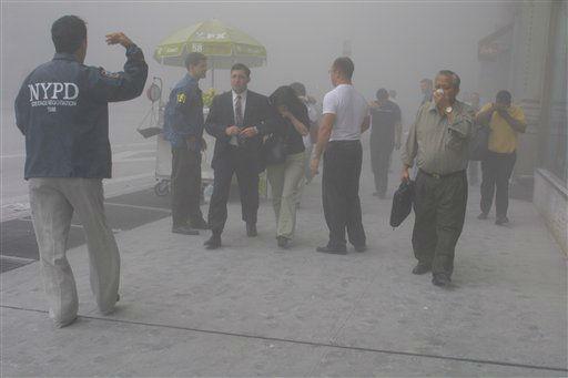 <div class='meta'><div class='origin-logo' data-origin='none'></div><span class='caption-text' data-credit='AP Photo/ Diane Bondareff'>People flee the scene near New York's World Trade Center after terrorists crashed two planes into the towers on Tuesday, September 11, 2001.</span></div>