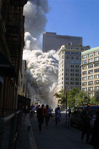 <div class='meta'><div class='origin-logo' data-origin='none'></div><span class='caption-text' data-credit='Photo/Diane Bondareff'>The north tower of the World Trade Center collapses on September 11, 2001 in New York City.</span></div>