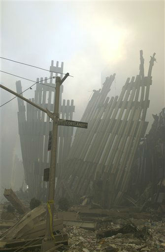 "<div class=""meta image-caption""><div class=""origin-logo origin-image ""><span></span></div><span class=""caption-text"">Ground zero on the evening of Sept. 11, 2001 after the September 11 terrorist attacks on the World Trade Center in New York City. (Photo/Mark Lennihan)</span></div>"