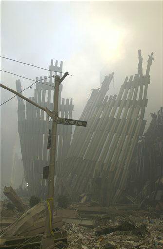 <div class='meta'><div class='origin-logo' data-origin='none'></div><span class='caption-text' data-credit='Photo/Mark Lennihan'>Ground zero on the evening of Sept. 11, 2001 after the September 11 terrorist attacks on the World Trade Center in New York City.</span></div>