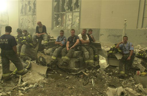 <div class='meta'><div class='origin-logo' data-origin='none'></div><span class='caption-text' data-credit='AP Photo/ Mark Lennihan'>Emergency workers at ground zero on Sept. 11, 2001 after the terrorist attacks on the World Trade Center in New York City.</span></div>