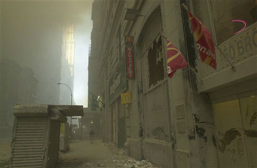 "<div class=""meta image-caption""><div class=""origin-logo origin-image none""><span>none</span></div><span class=""caption-text"">A street near ground zero on the evening of September 11, 2001 after the September 11 terrorist attacks on the World Trade Center in New York City. (AP Photo/ Mark Lennihan)</span></div>"
