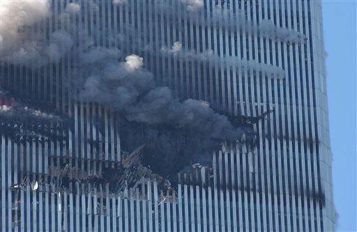 "<div class=""meta image-caption""><div class=""origin-logo origin-image none""><span>none</span></div><span class=""caption-text"">The north tower of the World Trade Center's twin towers burns after a hijacked plane crashed into it on September 11, 2001 in New York City. (AP Photo/ Louis Lanzano)</span></div>"