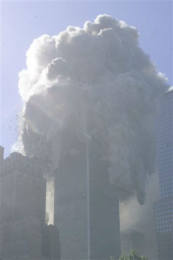 "<div class=""meta image-caption""><div class=""origin-logo origin-image none""><span>none</span></div><span class=""caption-text"">The north tower of the World Trade Center collapses after a hijacked plane crashed into it on September 11, 2001 in New York City. (AP Photo/ Richard Drew)</span></div>"