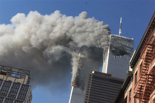 "<div class=""meta image-caption""><div class=""origin-logo origin-image none""><span>none</span></div><span class=""caption-text"">Smoke rises from the burning twin towers of the World Trade Center after hijacked planes crashed into the towers on September 11, 2001 in New York City. (AP Photo/ Richard Drew)</span></div>"