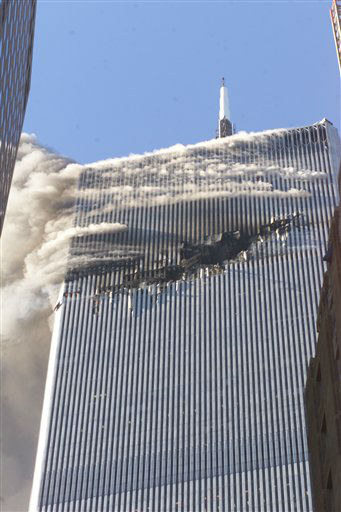 "<div class=""meta image-caption""><div class=""origin-logo origin-image none""><span>none</span></div><span class=""caption-text"">Debris fall from one of the burning twin towers of the World Trade Center after a hijacked plane crashed into the tower on September 11, 2001 in New York City. (AP Photo/ Richard Drew)</span></div>"